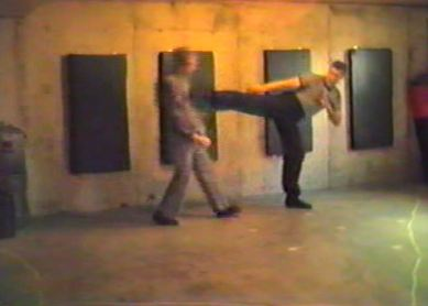 Tom Throwing Side Kick in 1980s Basement Class